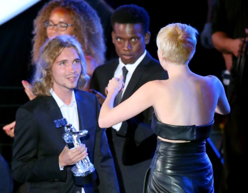 My Friend's Place representative Jesse (L) accepts Video of the Year with singer Miley Cyrus for 'Wrecking Ball' onstage during the 2014 MTV Video Music Awards at The Forum on August 24, 2014 in Inglewood, California.  (Photo by Mark Davis/Getty Images)